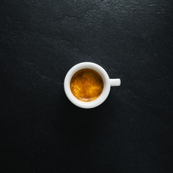 Cup of fresh made coffee served in cup on dark background. Coffee background.  Square.
