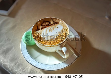 Cup of Golden Cappuccino in Abu Dhabi. Coffee with gold decoration. UAE.  United Arab Emirates.