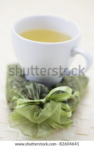 cup of green tea with dry leaves - tea time /shallow DOF/