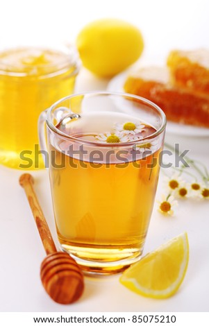 cup of herbal tea with chamomile and lemon