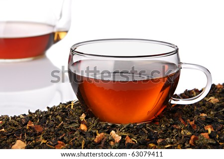 Cup of herbal tea with tea leaves - stock photo