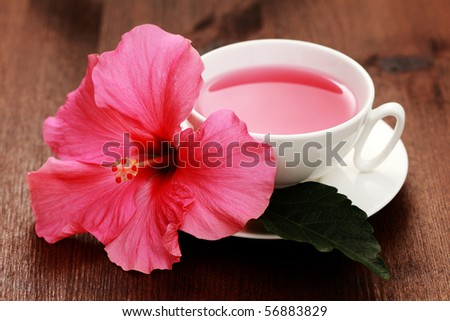 cup of hibiscus tea with beauty flower - tea time
