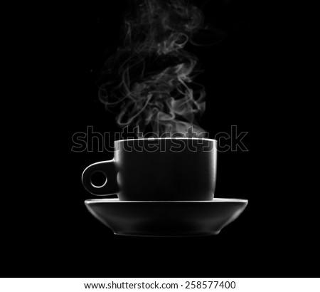 Cup of hot beverage on black
