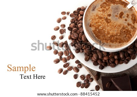 cup of hot cappuccino and coffee beans isolated on a white background