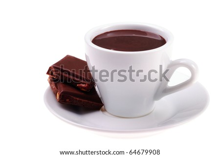 cup of hot chocolate and sliced dessert with hazelnuts isolated on white background