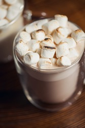 Cup of hot chocolate drink topped marshmallows, a warm cosy winter drink