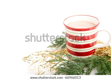 Cup of hot chocolate for Christmas morning and new year with candies cane, candies, fir and cones isolated on a white background