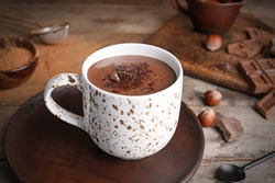 Cup of hot chocolate on wooden table