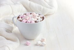 cup of hot chocolate with marshmallow, toned, copy space