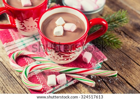 Cup of hot chocolate with marshmallows on a wooden table
