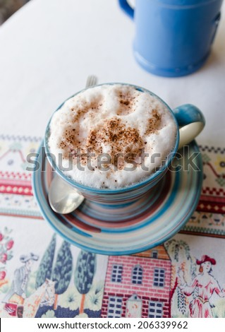Cup of hot cocoa and cream.