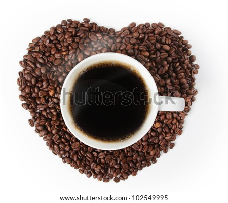 Cup of hot coffee on a Heart shape made from coffee on white background
