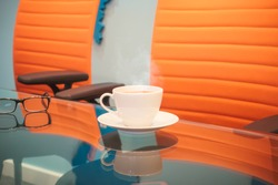 Cup of hot coffee on a table at a meetingroom.