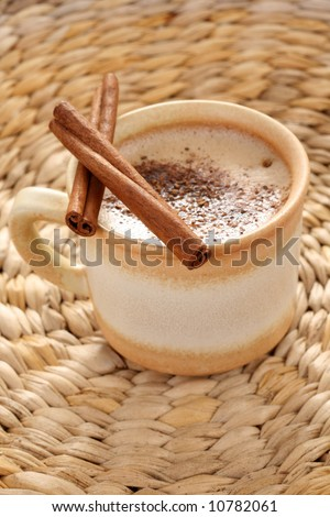cup of hot coffee with cinnamon - food and drink