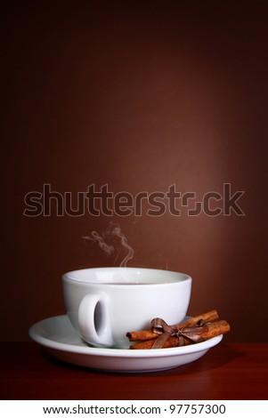 Cup of Hot Coffee with on a wooden table