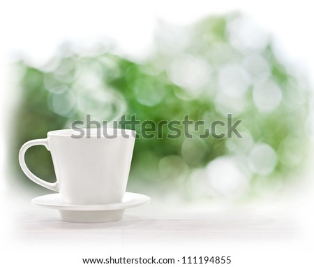 Photo of Cup of hot drink on summer background, free space for text