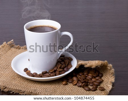 Cup of hot drink with coffee beam's
