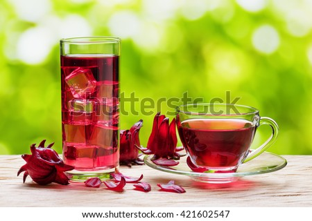 Shutterstock Cup of hot hibiscus tea (karkade, red sorrel, Agua de flor de Jamaica) and the same cold drink with ice in glass on nature background. Drink made from magenta calyces (sepals) of roselle flowers.