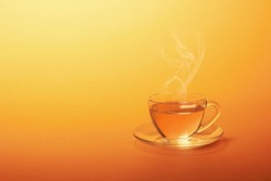 Cup of hot tea on a yellow background