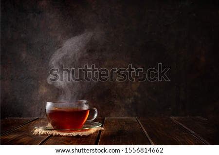Cup of hot tea with a steam on dark rustic background. Copy space Foto stock ©