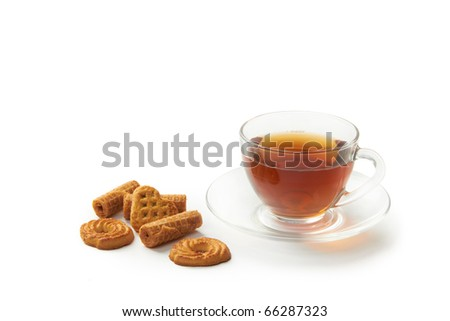 Cup of hot tea with cookies on a white background