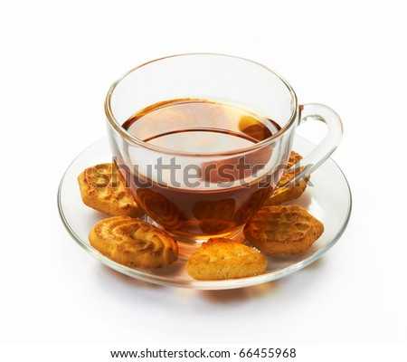 Cup of hot tea with cookies on a white background - stock photo