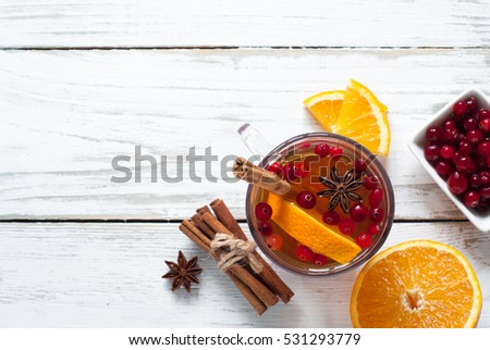 Cup of Hot tea with fruit and spices. Black fruit tea.