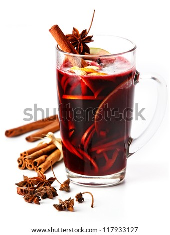 Cup of hot wine with spices on white background - stock photo