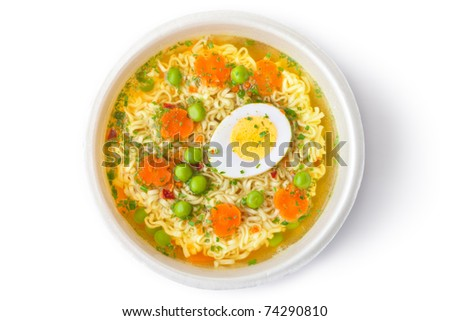 Cup of instant noodles with vegetables. Top view. Isolated on white.