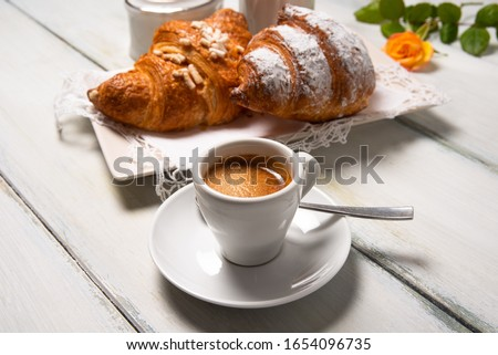Cup of italian espresso and brioches