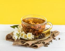 Cup of jasmine tea with flowers