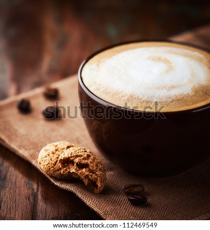 Cup of latte coffee with biscotti - stock photo