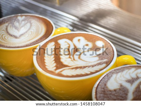 Cup of latte or cappuccino with latte art. Latte art coffee created by pouring steamed milk. #1458108047
