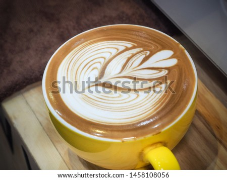 Cup of latte or cappuccino with latte art. Latte art coffee created by pouring steamed milk. #1458108056