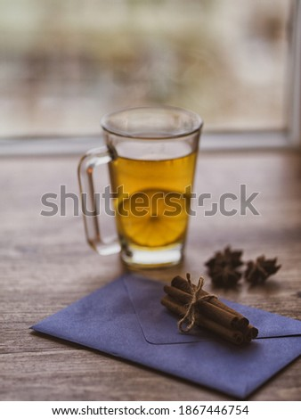 Cup of lemon hot tea honey and cinnamon stick on envelope with message with dried star anise (anason) .Cold season herbal drink detox . Copy text space Stok fotoğraf ©