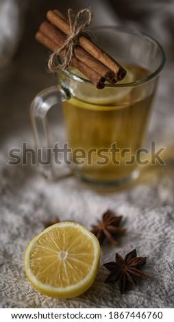 Cup of lemon hot tea honey and cinnamon stick with dried star anise (anason) cold season herbal drink detox Stok fotoğraf ©