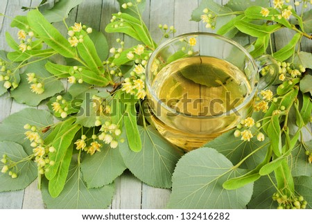 cup of lime tree tea and linden blossoms