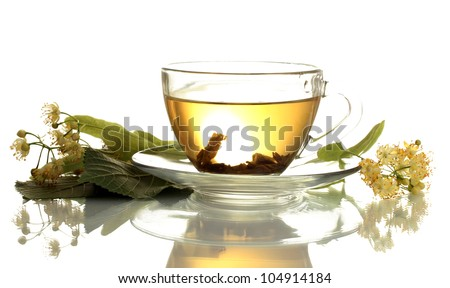 cup of linden tea and flowers isolated on white
