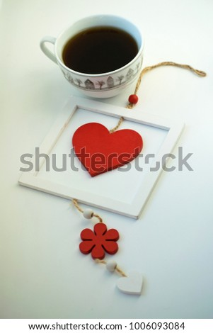 Cup of love, coffee with red heart. Red heart on a rope in the wooden frame. Valentine's day. Morning. The 14th of February. #1006093084