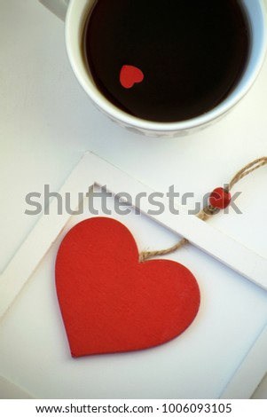 Cup of love, coffee with red heart. Red heart on a rope in the wooden frame. Valentine's day. Morning. The 14th of February. #1006093105