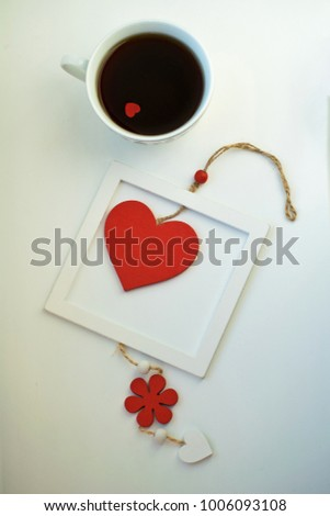 Cup of love, coffee with red heart. Red heart on a rope in the wooden frame. Valentine's day. Morning. The 14th of February. #1006093108