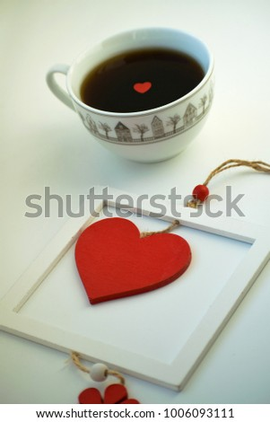 Cup of love, coffee with red heart. Red heart on a rope in the wooden frame. Valentine's day. Morning. The 14th of February. #1006093111