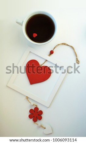 Cup of love, coffee with red heart. Red heart on a rope in the wooden frame. Valentine's day. Morning. The 14th of February. #1006093114
