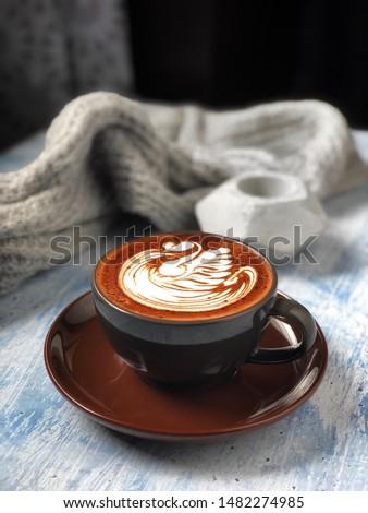 Cup of mocha latte with swan latte art on wooden table Stock fotó ©