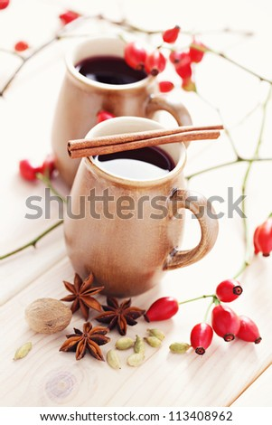 cup of mulled wine with spices - food and drink