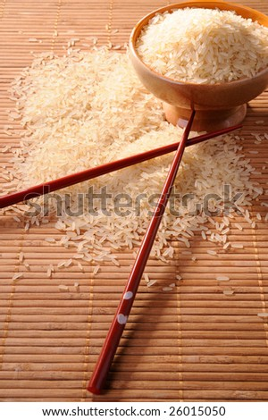 Cup of raw rice and chopsticks