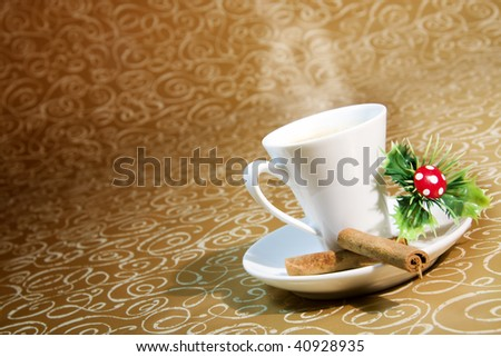 cup of steaming coffee with Christmas motifs on deep golden brown