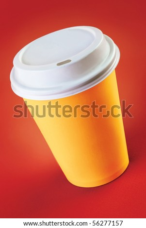 Cup of take-out coffee on a red background