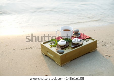 Cup of tea and candle at the sea #148616108
