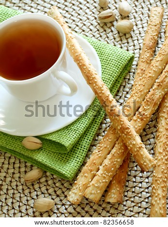 cup of tea and crispy straw on table